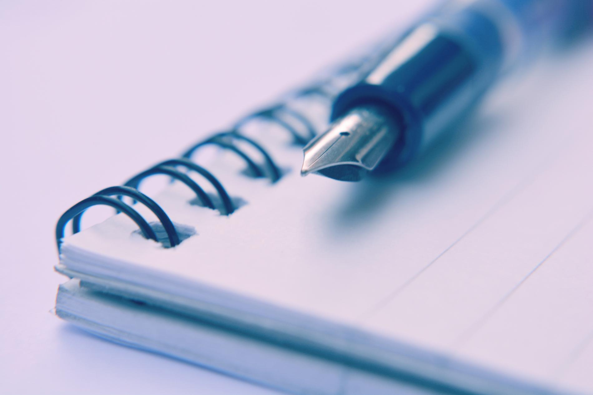 ink-pen-on-scribble-pad